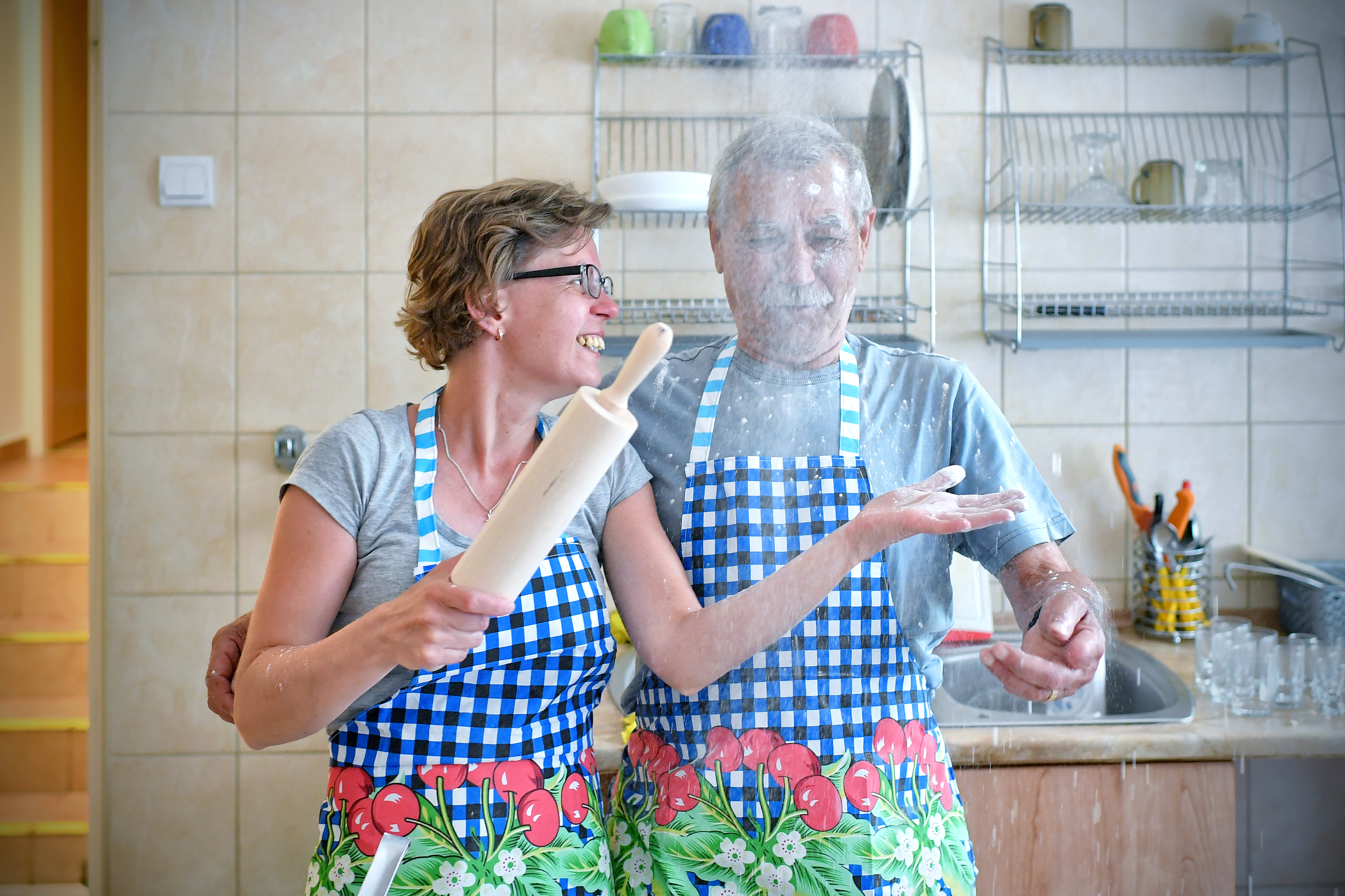 Woman and man baking cake during senior classes.