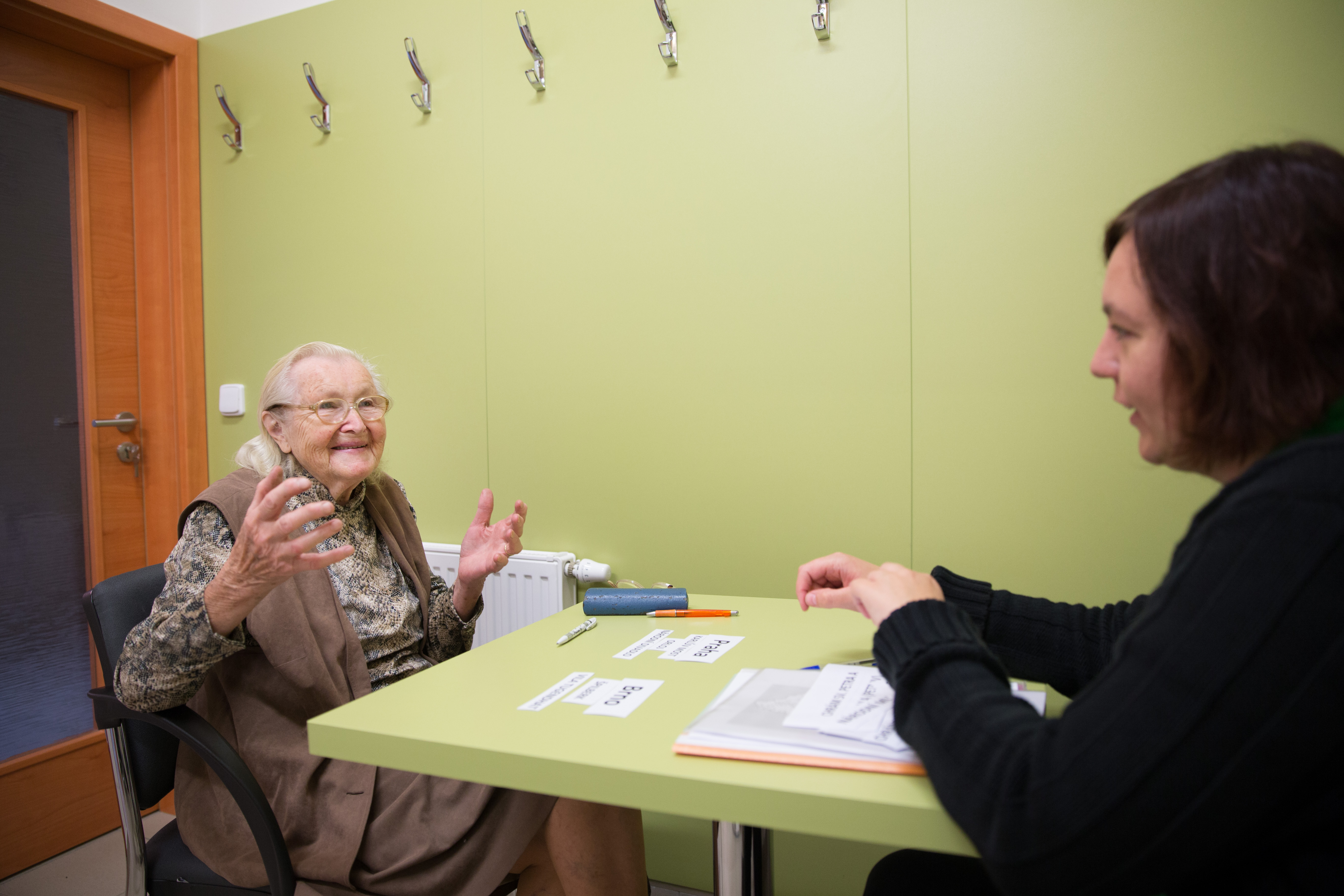 Elderly woman sitting and talking to a younger woman in care centre in Brtnice, Czech Republic. Phot. Michal Novotny
