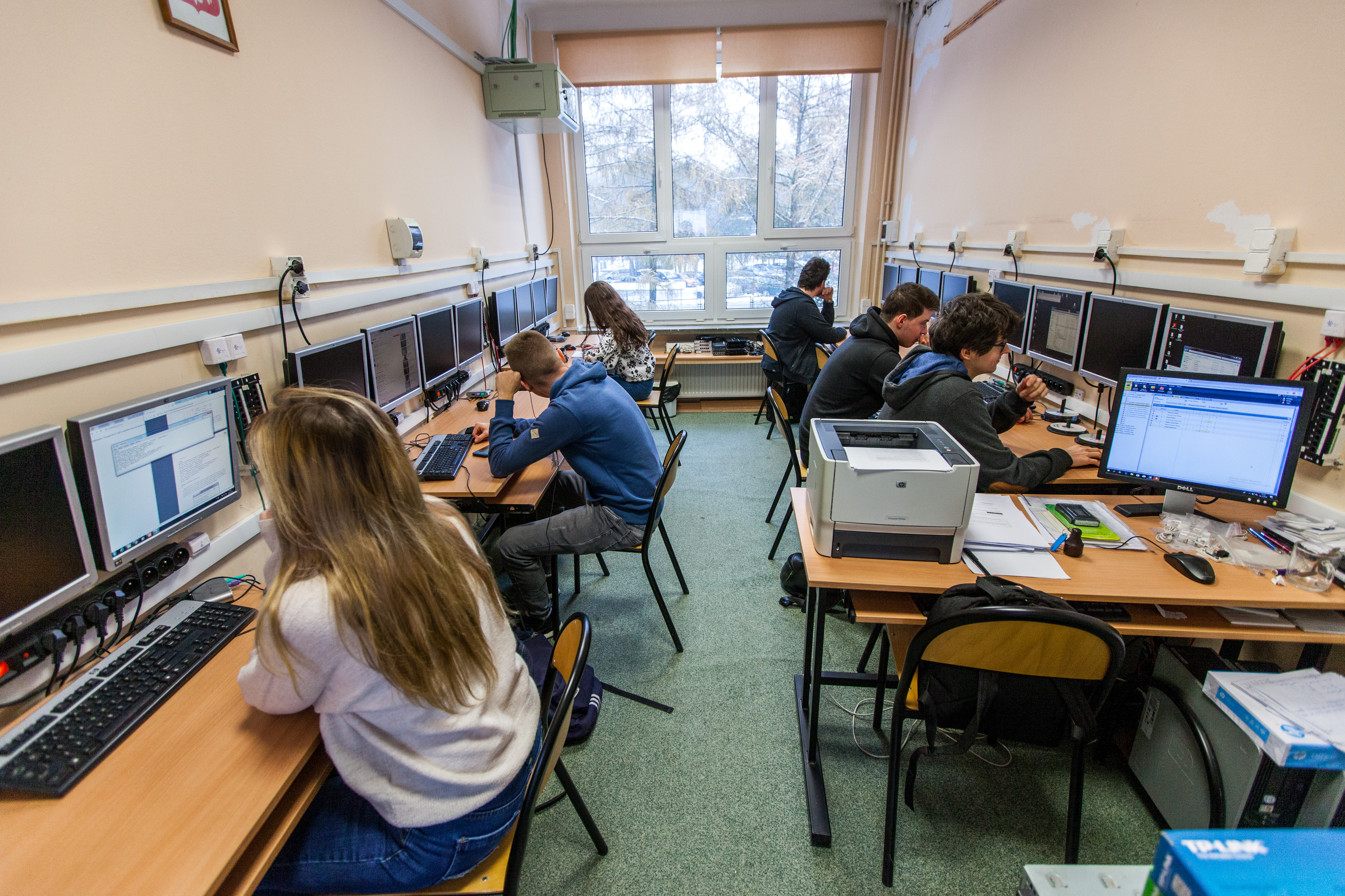 Group of students in a computer laboratory (ICT computer education).